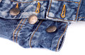 Buttons on blue jeans unfasten closeup white background Royalty Free Stock Photos