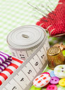 Buttons, colorful fabrics, measuring tape, pin cushion, thimble Royalty Free Stock Photo