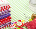 Buttons, colorful fabrics, measuring tape, pin cushion and thimble Royalty Free Stock Photo