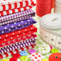 Buttons, colorful fabrics, measuring tape, pin cushion, thimble Stock Photo