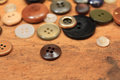 Buttons of various sizes and colors on wood background Stock Images