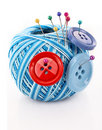Buttons and wool ball isolated Stock Images