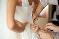 Butttoning Wedding Dress Stock Images