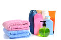 Butylki cosmetics and bath towels on white background Stock Images