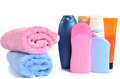 Butylki cosmetics and bath towels on white background Royalty Free Stock Image