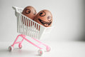 Buy basket concept. An egg with a painted face Royalty Free Stock Photo