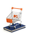 Buy the book shopping cart on blue clipping pack Royalty Free Stock Photography