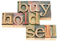 Buy hold sell in wood type investing concept isolated text letterpress printing blocks stained by color inks Royalty Free Stock Photos