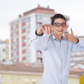 Buy house man with the keys to the real estate Stock Photography