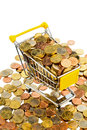 Buy a house shopping cart is filled with well euro coins symbolic photo for purchasing power and consumption Royalty Free Stock Photos