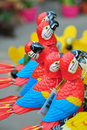 Buy me! - decorative parrot standing out in a row Stock Photos