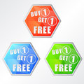 Buy one get one free three colors hexagons labels flat design business shopping concept Royalty Free Stock Photos