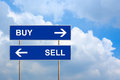 Buy and sell on blue road sign with sky Stock Images