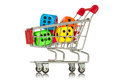 Buying games shopping cart with colorful dice inside Stock Photo