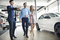 stock image of  Buying new car by couple