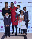 Bya awards black youth achievements in london uk th nov mother of the year category winner with kids sabrina ben salmi at the th Royalty Free Stock Images