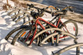 Bycicle in snow left the on a cold winter day Royalty Free Stock Photos