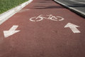 Bycicle symbol on a cycle path white reddish Royalty Free Stock Image