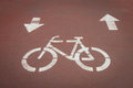 Bycicle symbol on a cycle path white reddish Royalty Free Stock Photo