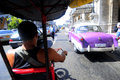Bycicle taxi on street of Havana Stock Images