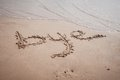 Bye written on sand in the beach of gandia spain Royalty Free Stock Images