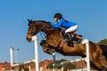 Caballo rider jump blue girl Fotografía de archivo