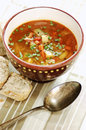Cabbage soup delicious with black cumin and and chive wholemeal bread selective focus Stock Image