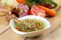 Cabbage soup gourmet vegetable in white bowl and ingredients with smoked pork ribs tomatoes spring onion leek carrot garlic and Stock Image