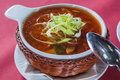 Cabbage soup in a wicker plate crackers and sour cream Royalty Free Stock Image