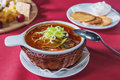 Cabbage soup in a wicker plate with crackers and sour cream Royalty Free Stock Image