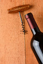 Cabernet bottle and corkscrew on wood a rustic wooden surface the antique opener are at an angle leaving plenty of copy Stock Images