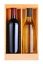 Cabernet and Chardonnay Bottles in Wood Box Royalty Free Stock Photos