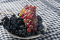 Cabernet grape on plate close up photo Royalty Free Stock Photo