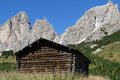 A cabin by jagged mountains log in northern italy the dolomites part of the italian alps Royalty Free Stock Photos