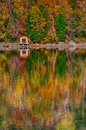Cabin on the waters edge a small sitting of water with autumn colours reflecting lake Royalty Free Stock Photos