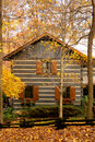 Cabin in the woods with autumn Royalty Free Stock Photo