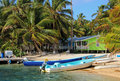 Cabins on stilts on the small island of Tobacco Caye, Belize