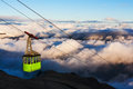Cable car above clouds Stock Image