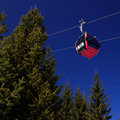 Cable car aerial tramway with clear blue sky Stock Images