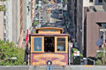 Cable car climbing hill in san francisco california usa august front face of a arriving at the end of a steep uphill the Royalty Free Stock Images