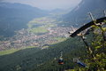 Cable car over garmisch on top of mountain with the town of partenkirchen in the background Stock Image