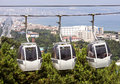 Cable car with three cabins running over the forest beautiful scenery in the background in samsun turkey Royalty Free Stock Photos