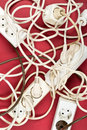 Cable chaos clutter from multiple electric wire extension cords Royalty Free Stock Photo