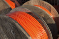 Cable drums with orange fiber on it Royalty Free Stock Photo