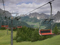Cable railway in the dolomites corvara italy picture of alta badia village taken from with mountain range background Stock Photography