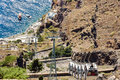 Cable road down to old port of thira town on santorini island greece Stock Photos