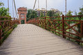Cable-stayed bridge with planked deck and rusted h Royalty Free Stock Photo
