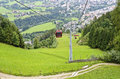 Cable way to a mountain hoovering over a road way gondola of the the castle lienz eastern tirol austria Stock Photos