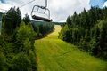 Cableway upon downhill course harrachov Royalty Free Stock Images