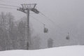 Cableway at heavy snowing weather view on Royalty Free Stock Photo